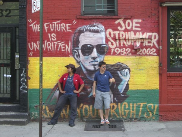 Me and my friend Brian at the Tompkins Square mural of Joe Strummer, circa 2008.