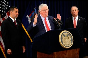 Flanked by Mayor Bloomberg and Governor Paterson. Photo courtesy of the NY Times.