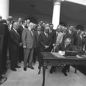 Signing of bill establishing the Department of Housing and Urban Development (HUD), 1965. [LBJ Library, photo by Donald Stoderl]