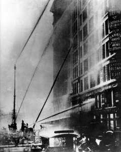 Firemen desperately try to put out fire, but hoses don't reach the top floors. Photo from Cornell archives.