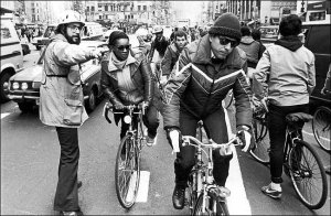 A Transportation Alternatives volunteer directs hordes of bikers commuting to work.