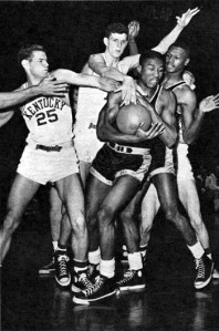 CCNY star Ed Warner battles with Kentucky.