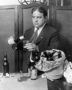La Guardia pouring beer in office during Prohibition. (LaGuardia Wagner Archives.)