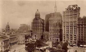 The New York World, Herald and Times, from left to right, across from City Hall. The New York World building was demolished in 1955 to rebuild the approach to the Brooklyn Bridge.
