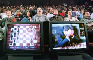 The crowd watches in shock as Deep Blue takes the win. (Image from Reuters.)