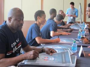 Ewing signing posters at a fundraiser for President Obama at Chelsea Piers.