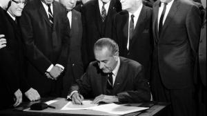 LBJ signing the Fair Housing Act, one of the last bills of the Great Society. Image from The Root.